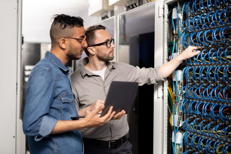 IT support workers onsite resolving problem